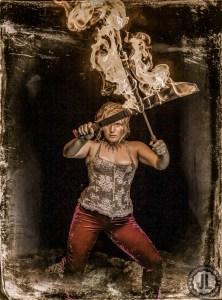 Opal del Sol fire performer machetes
