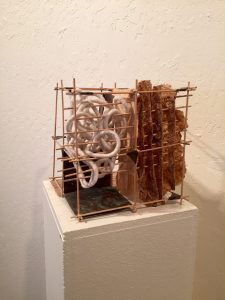 """Turn It Around"" by Darlene Boyd. Hand made paper, jute, string, bamboo, copper."