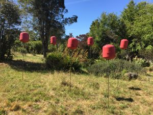 """""""Gas Field"""", by Ethan Estess. Reclaimed gas tanks and steel."""