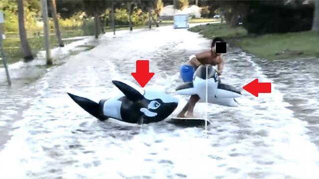 avec-les-inondations-ils-font-du-surf-en-pleine-rue-video.jpg