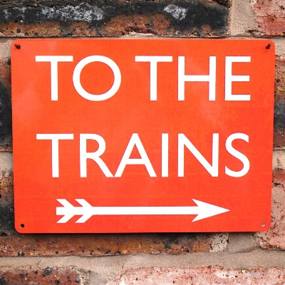 To The Trains Sign – Red Right Arrow