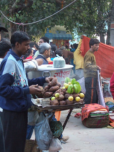 Delhi vendor selling starfruit and roasted sweet potatotes