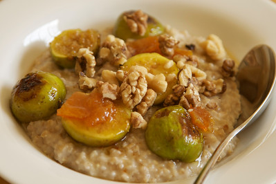 Breakfast oatmeal served with caramelized figs, toasted walnuts and homemade orange marmalade