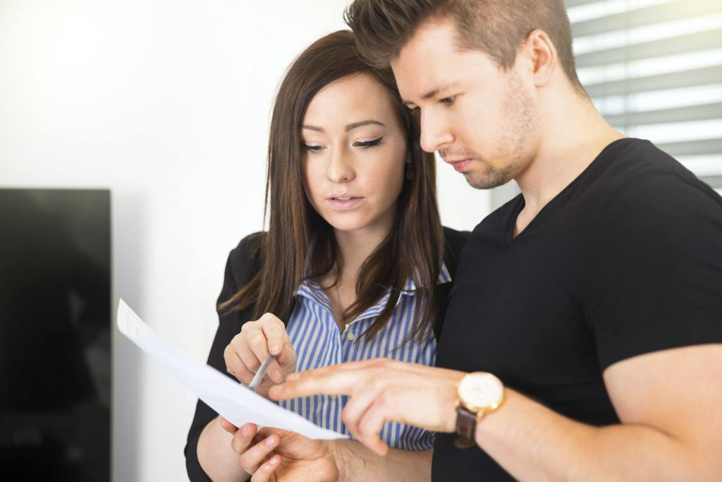 Business People Reading Document In Office