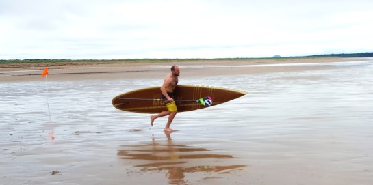 Neil Craig running with Motion at SUP Nationals