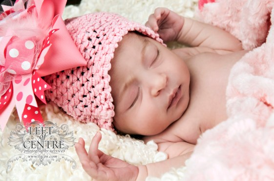 baby sleeping with pink hat