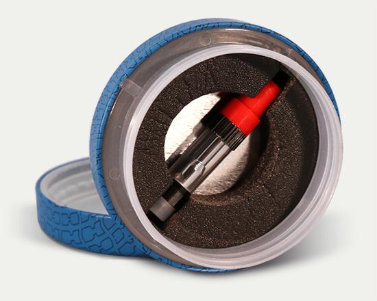 Round cannabis tin with an insert holding a vape cartridge.