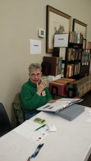 Lynn worked the book sale while catching up on her reading.