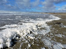 High surf caused by strong winds brings lots of sea foam