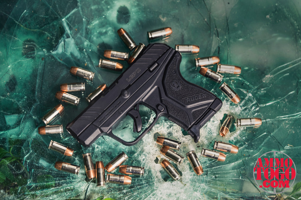 photo of ruger lcr handgun on broken glass