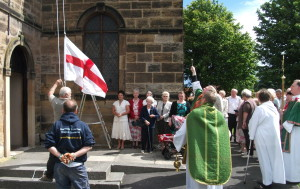 The Flagpole and Flag are blest as the St George's Flag flies for the first time on the new Flagpole.