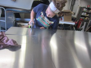 My dad, sister, and I are building a Lotus sports car! Here I'm just cutting some sheet metal for the side panels of the frame.