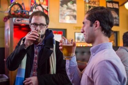 Steve Weishampel (left) and Joseph Eliya socialize at January's Neighbor Meetup. Photo: Dana J. Ardell
