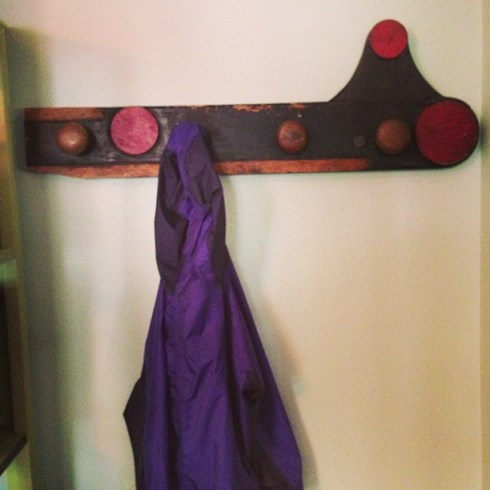 One_very_cool_coat_rack_that_I_made_w_old_door_knobs_and_a_piece_of__salvage_wood_from_the_Eagle_Ironworks_plant