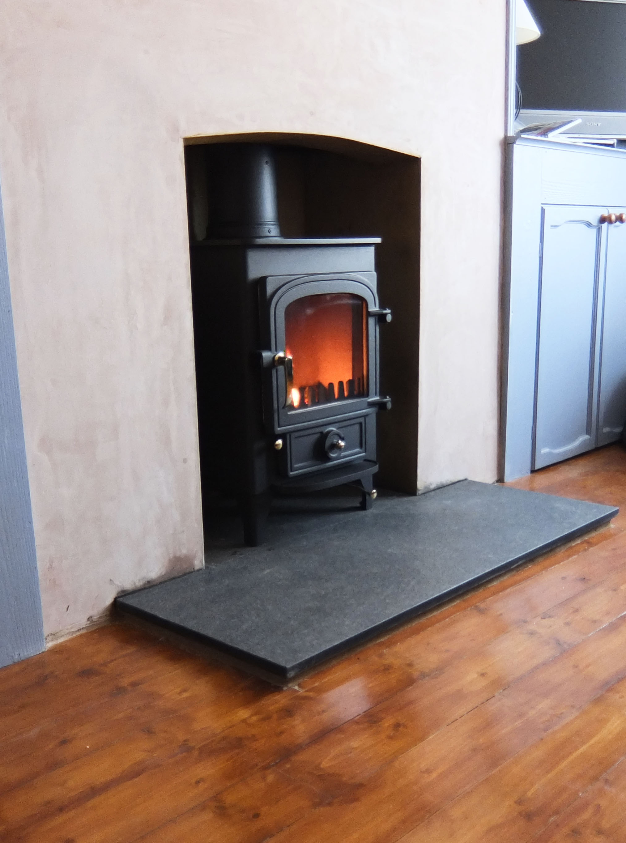 Wood Burning Stove with Granite Hearth  Fire Bug Wood Burning Installation