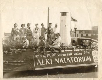 A parade float promoting the Alki Natatorium with famous swimmer Helene Madison seated on the left