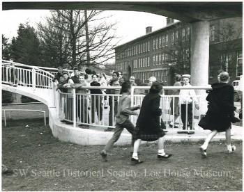 Cooper School students in Youngstown crossing the new pedestrian overpass bridging busy Delridge Way.