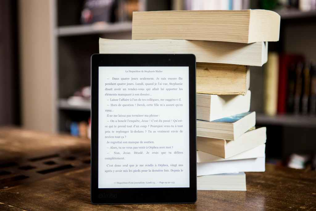 eReader in front of a stack of books