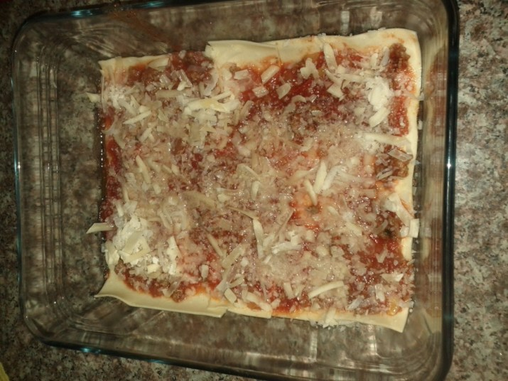 Layer 3, tomato sauce topped with Parmesan (Parmigiano) Cheese