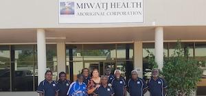 Miwatj board members standing in front of headquarters