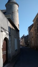 Tower, front door, and medieval street of rue St. Denis.