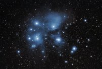 """Caption for """"Pleiades – Joel Tonyan – January 25 2014.jpg"""" The Pleiades, otherwise known as M45 or the Seven Sisters, imaged from Fayetteville, Arkansas, on January 25th, 2014. Taken with a TMB92L, Canon T3i DSLR, Orion SSAG autoguider and 50mm guidescope, and Celestron AVX mount. Consists of 42 240-second light frames and 30 240-second dark frames, all at ISO 800, as well as 15 flat and 30 bias frames."""