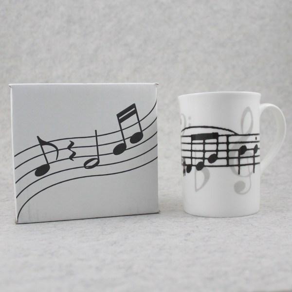 caneca porcelana partitura e caixa para oferta