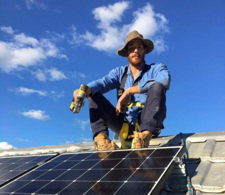Nick Lokic from Lokic Energy Solutions working on a commercial roof installing a solar solution