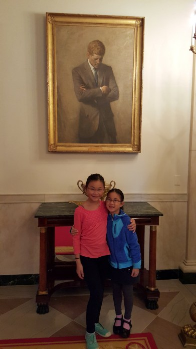Here we are under the famous portrait of President Kennedy.
