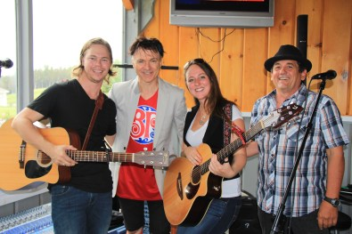 Caleb Hutton & Megan Hutton of Instant Rivalry flanking Lawrence Gowan with Denis Marcil
