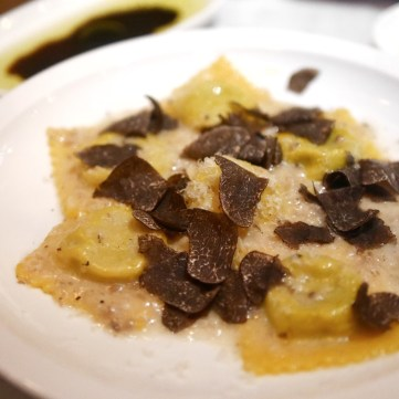 Ravioli with black truffle and asparagus