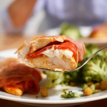 Chicken breast stuffed with piquillo peppers and cream cheese, wrapped in parma ham