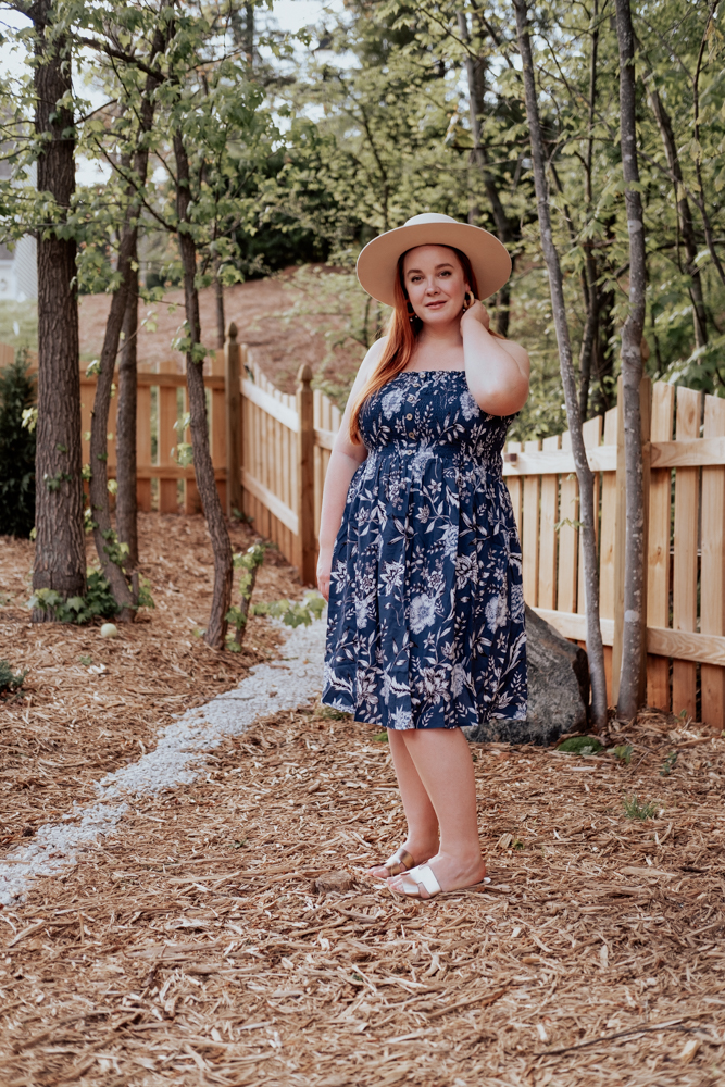 curvy blogger wearing navy floral summer dress from pink blush plus size women's collection