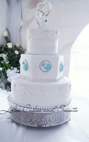 """""""Love Bird"""" a classic white buttercream wedding cake with love dove brooches."""