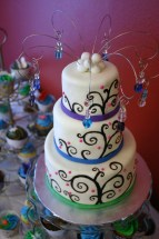 Peacock-esque mini wedding cake