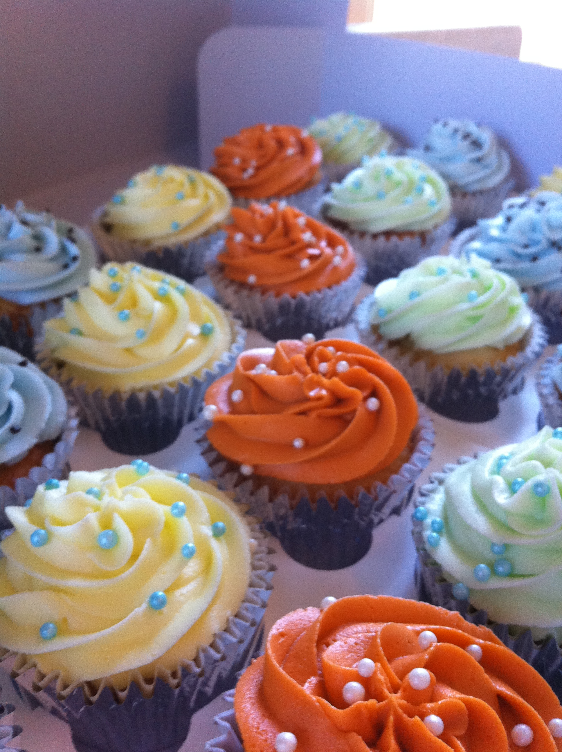 Orange yellow blue green baby shower cupcakes  Lolos Cakes  Sweets