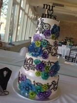 """Elizabeth Ann"" Paisley & watercolor daisy wedding cake in blue, teal, lime & purple Feeds 80. MSRP $475"