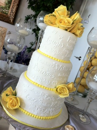 """""""Erin"""" 3 tier wedding cake with love notes & yellow accents. Feeds 75. MSRP $350"""