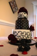 """""""Sherrill"""" Black & white 3 tier wedding cake with red roses - Photo taken at the reception venue of the Compass Rose in Niceville, FL"""