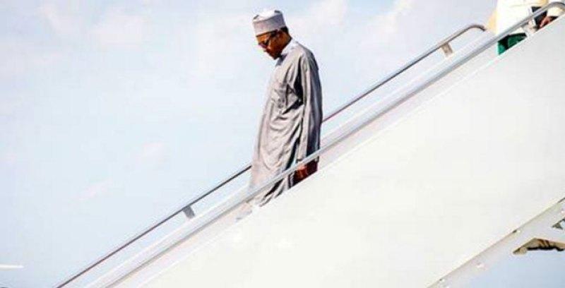 The president of Nigeria, Muhammadu Buhari descending the stairs of airplane