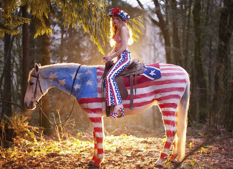 I think the horse looks better than the lady on it.