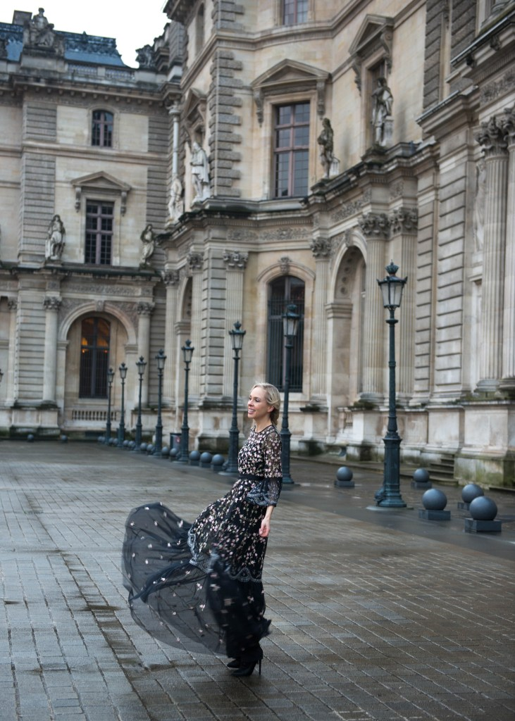 Needle & Thread Climbing Blossom Dress, at The Louvre Paris, Valentine's Day, Vera Wang Tux    Stunning embroidered Needle & Thread featured by top San Francisco fashion blog, Lombard and Fifth: image of a woman wearing a Embroidered Needle & Thread gown and black heeled booties and a man wearing a Men's Wearhouse Black tuxedo in the Tuileries in Paris