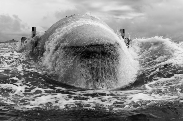 Wave energy being harnessed near the Scottish Orkney Islands by . © Stuart Franklin & Magnem Photos.