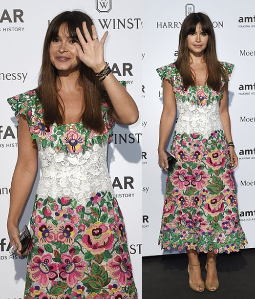Russian fashion editor Miroslava Duma waves as she arrives for the amfAR dinner on the sidelines of the Paris fashion week in Paris on July 5, 2015. AFP PHOTO / LOIC VENANCE (Photo credit should read LOIC VENANCE/AFP/Getty Images)