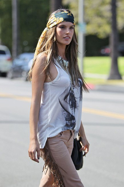 Alessandra Ambrosio modelling the hippy look wearing head scarf and tasseled trousers for a video and photo shoot in Beverly Hills. Los Angeles, California
