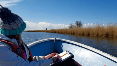 Lucy undertakes fieldwork across the Norfolk Broads. Image by Lucy Roberts.