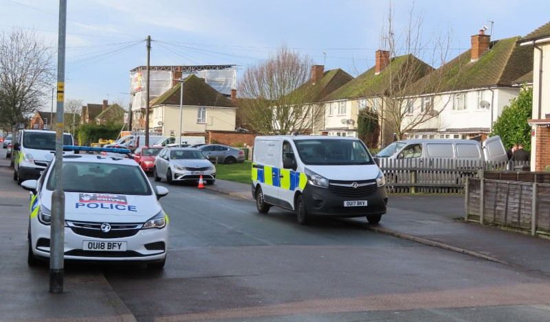 Three Forensic vans, and police cars.