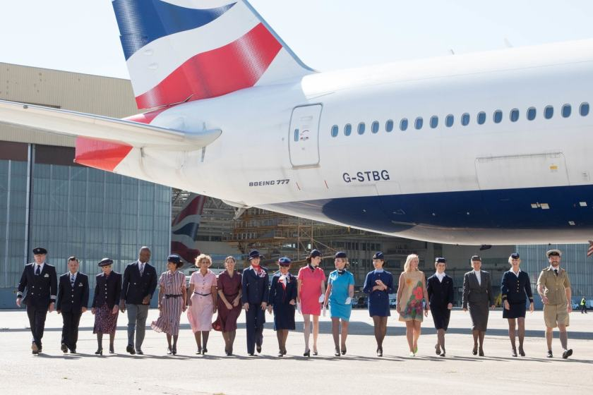 British Airways staff wearing historic uniforms from BA and its predecessor airlines