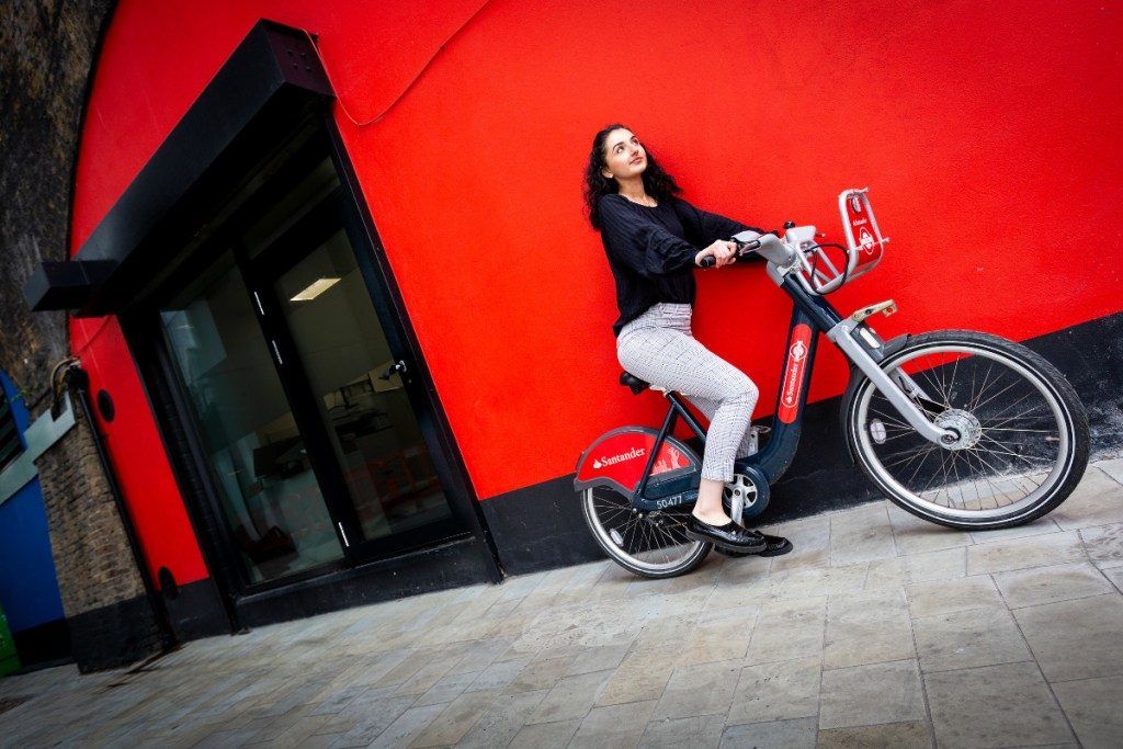 GWoman posing on a Santander Cycles bike