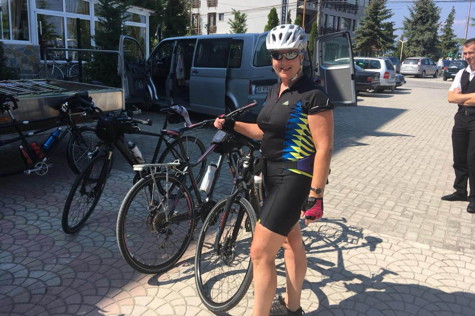 Marie poses with her bicycle on holiday whilst cycling training